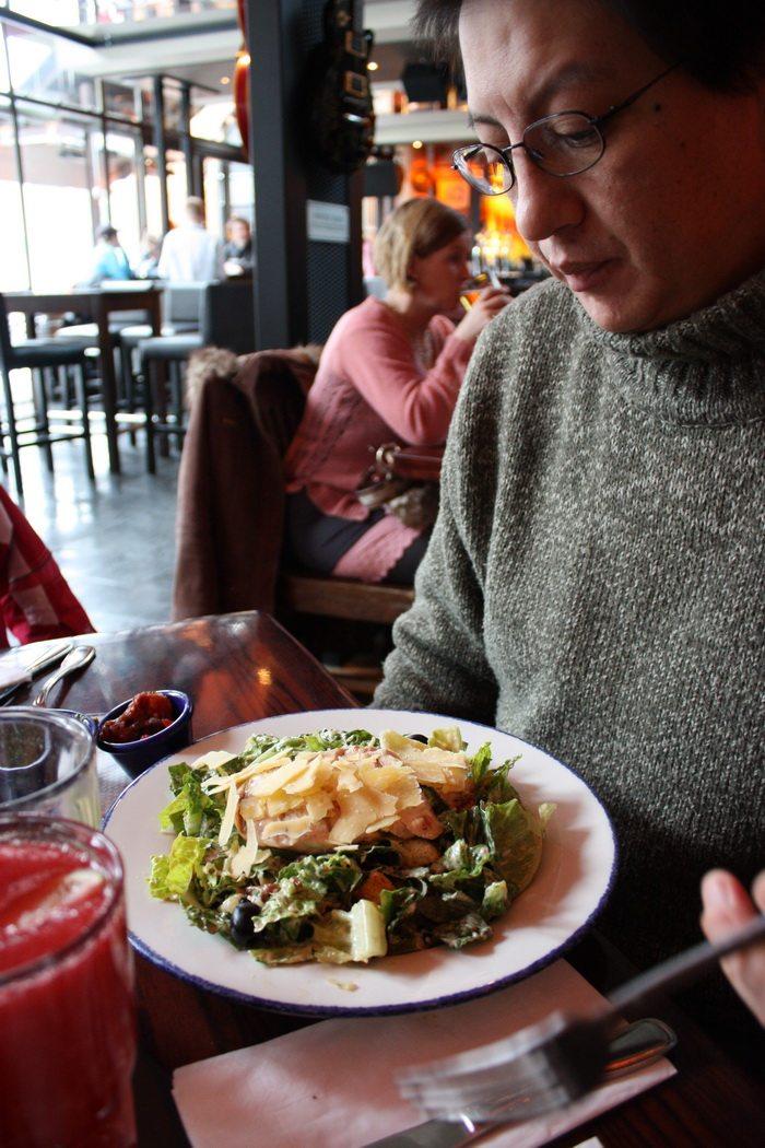 dad eating Caesar salad at hard rock cafe copehagen