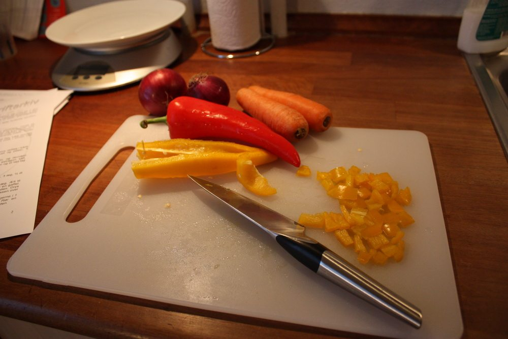chopping vegetables for lasagne