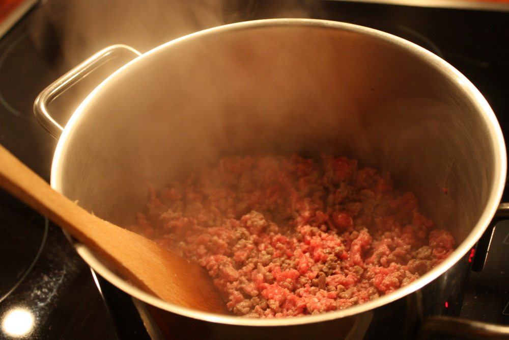 minced beef for lasagne in pot