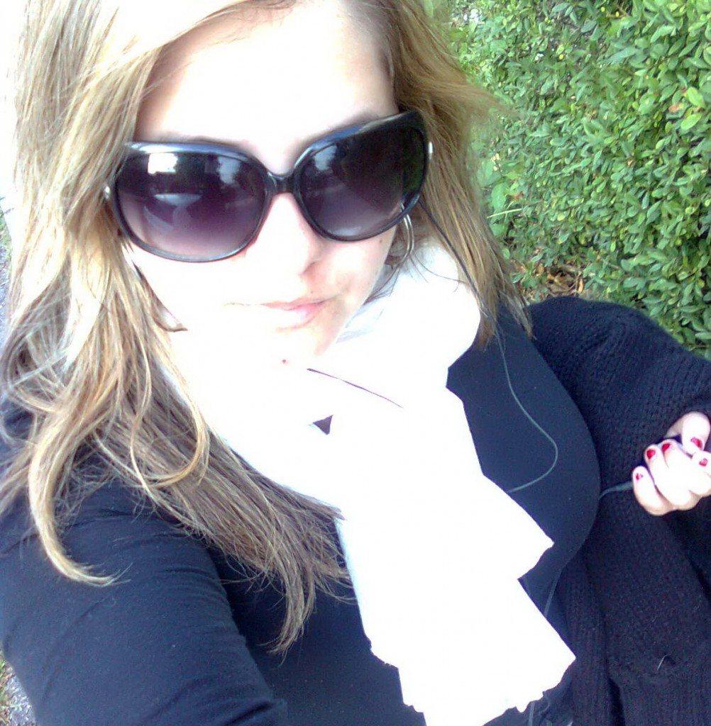 Selfie of leah walking on a street to school