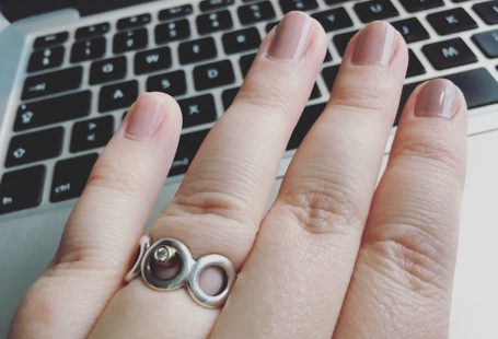 Laptop, nail varnish, jewelry