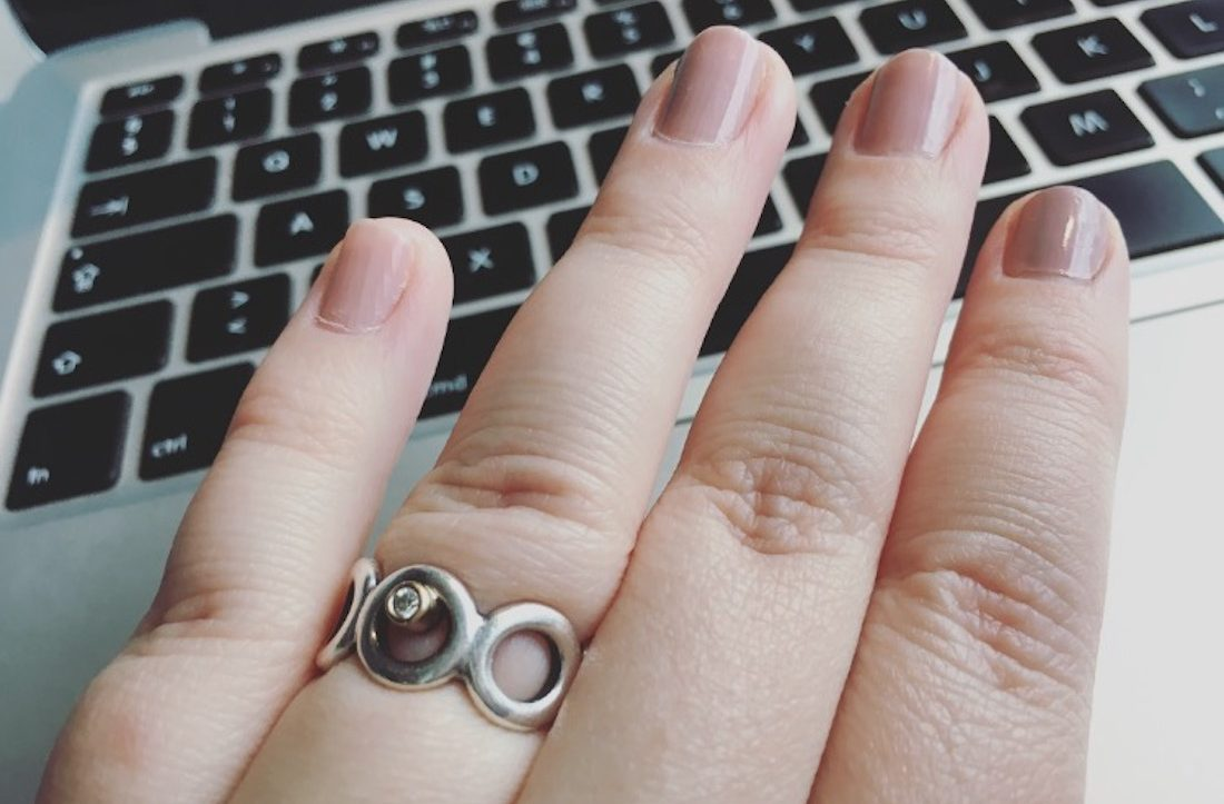 laptop, nail varnish and jewelry