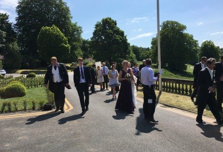 matt walking in the sun outside at kath and scotts wedding