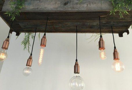 light baubles in a wooden box in the ceiling