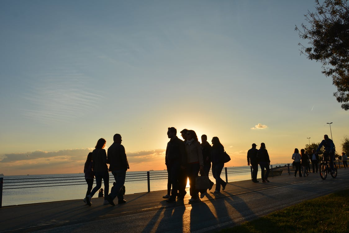People walking near ocean